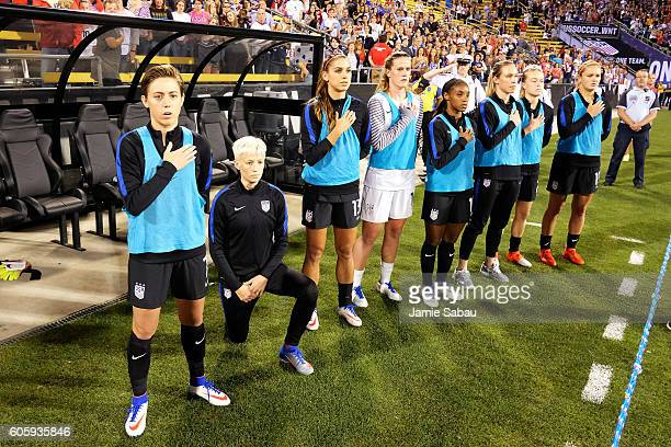 Megan Rapinoe of the US Women's National Team kneels during the playing of the US National Anthem before a match against Thailand on September 15...