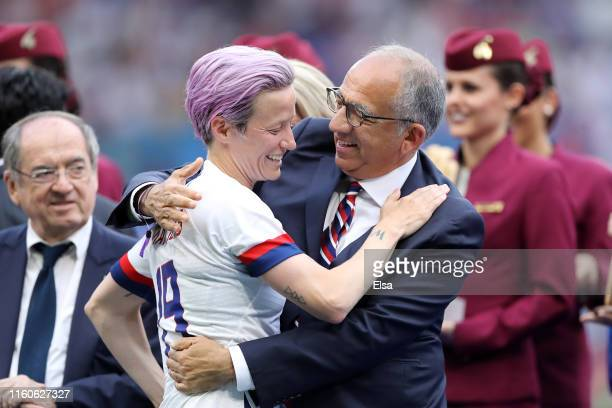 Megan Rapinoe of the USA and Carlos Cordeiro President of the USA Soccer Federation celebrate following their sides victory in the 2019 FIFA Women's...