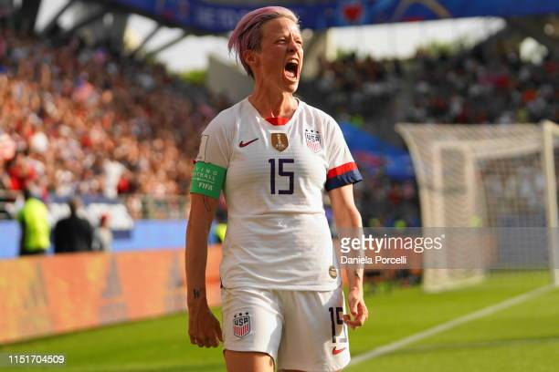 Megan Rapinoe of the USA celebrates scoring a goal from the penalty spot after a VAR during the 2019 FIFA Women's World Cup France Round Of 16 match...