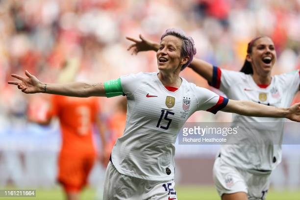 Megan Rapinoe of the USA celebrates scoring the first goal from the penalty spot with Alex Morgan during the 2019 FIFA Women's World Cup France Final...