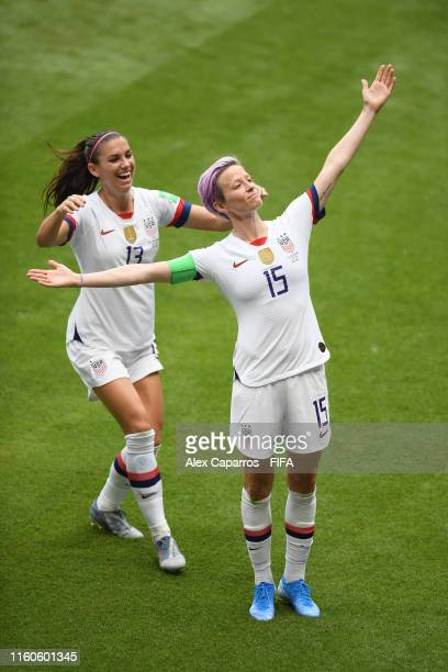 Megan Rapinoe of the USA celebrates with teammate Alex Morgan after scoring her team's first goal during the 2019 FIFA Women's World Cup France Final...