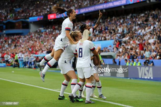 Megan Rapinoe of the USA celebrates with teammates after scoring her team's first goal during the 2019 FIFA Women's World Cup France Quarter Final...