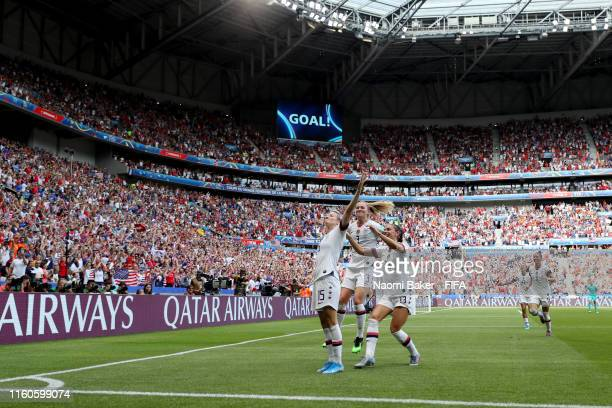 Megan Rapinoe of the USA celebrates with teammates after scoring her team's first goal during the 2019 FIFA Women's World Cup France Final match...