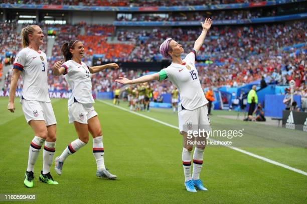 Megan Rapinoe of the USA celebrates with teammates Alex Morgan and Samantha Mewis after scoring her team's first goal during the 2019 FIFA Women's...
