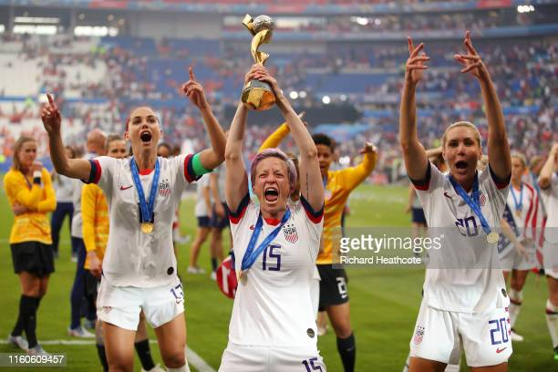 Megan Rapinoe of the USA celebrates with the FIFA Women's World Cup Trophy following her team's victory in the 2019 FIFA Women's World Cup France...