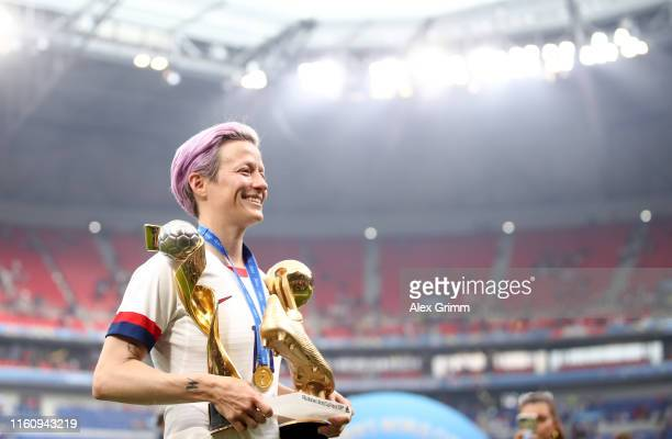 Megan Rapinoe of the USA celebrates with the FIFA Women's World Cup Trophy, the Golden Boot and The Golden Ball following the 2019 FIFA Women's World...
