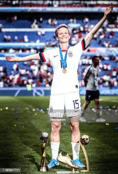 Megan Rapinoe of the USA celebrates with the FIFA Women's World Cup Trophy the Golden Boot and The Golden Ball following the 2019 FIFA Women's World...