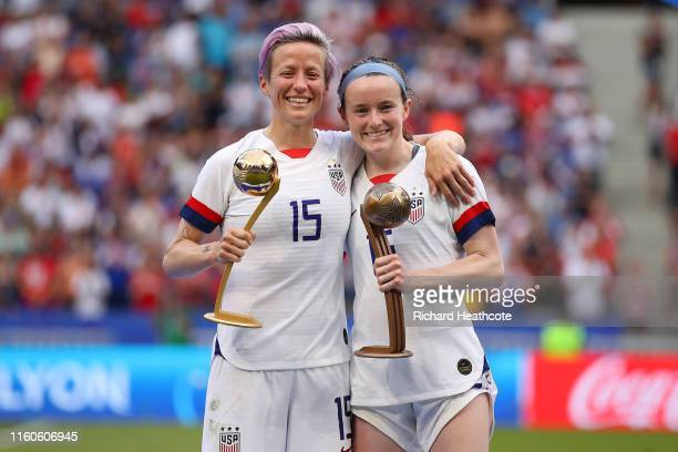 Megan Rapinoe of the USA celebrates with the Golden Ball award and teammate Rose Lavelle celebrates with the Bronze Ball award following the 2019...
