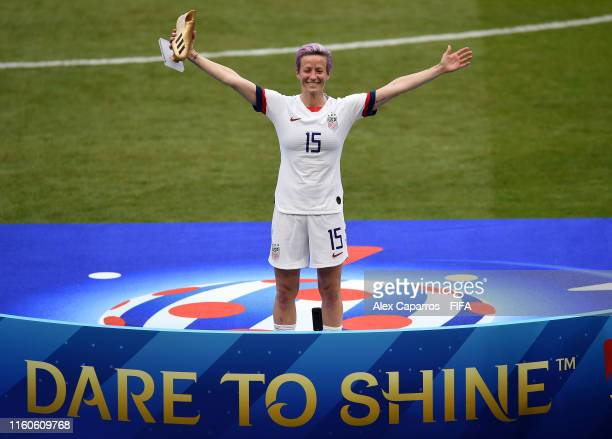 Megan Rapinoe of the USA celebrates with the Golden Boot award following the 2019 FIFA Women's World Cup France Final match between The United States...