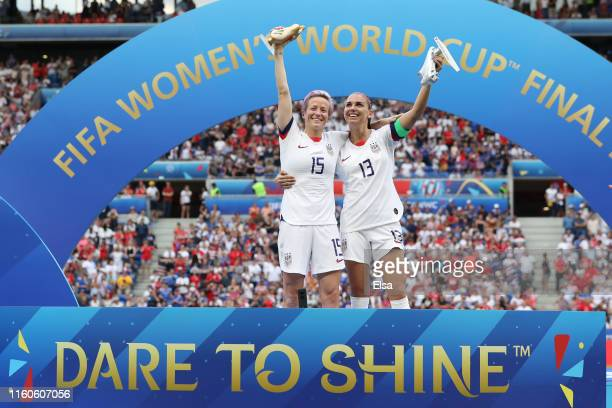 Megan Rapinoe of the USA golden ball and Alex Morgan of the USA silver boot pose with their respective trophies after the 2019 FIFA Women's World Cup...