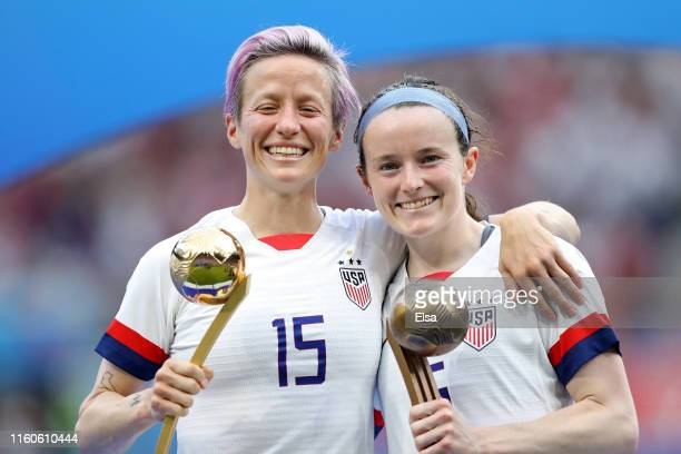Megan Rapinoe of the USA, golden ball and teammate Rose Lavelle, bronze ball pose with their respective trophies after the 2019 FIFA Women's World...