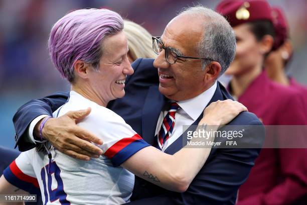 Megan Rapinoe of the USA hugs Carlos Cordeiro President of the USA Soccer Federation after the 2019 FIFA Women's World Cup France Final match between...