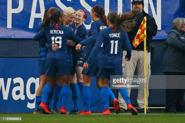 Megan Rapinoe of the USA is congratulated by teammates Crystal Dunn Mallory Pugh and Alex Morgan after a goal against England of the 2019 SheBelieves...