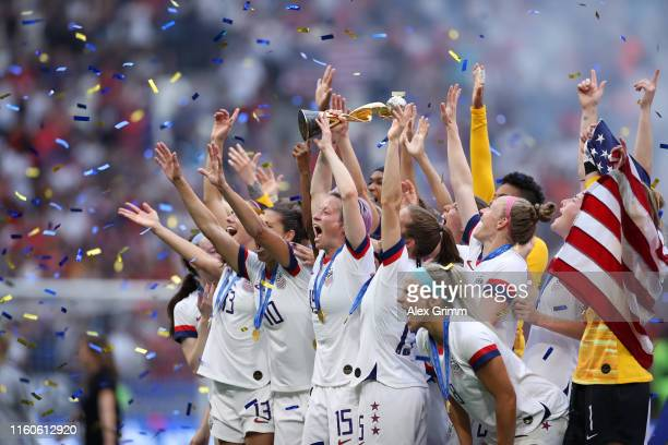 Megan Rapinoe of the USA lifts the FIFA Women's World Cup Trophy following her team's victory in the 2019 FIFA Women's World Cup France Final match...
