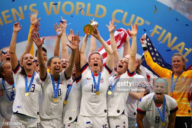 Megan Rapinoe of the USA lifts the trophy as USA celebrate victory during the 2019 FIFA Women's World Cup France Final match between The United State...