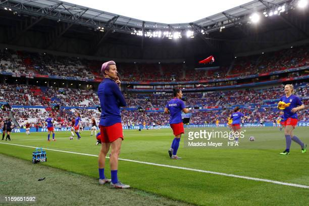 Megan Rapinoe of the USA looks on as her teammates warm up prior to the 2019 FIFA Women's World Cup France Semi Final match between England and USA...