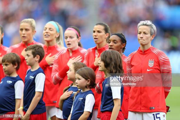 Megan Rapinoe of the USA looks on as the rest of the USA team sing the national anthem during the 2019 FIFA Women's World Cup France Quarter Final...