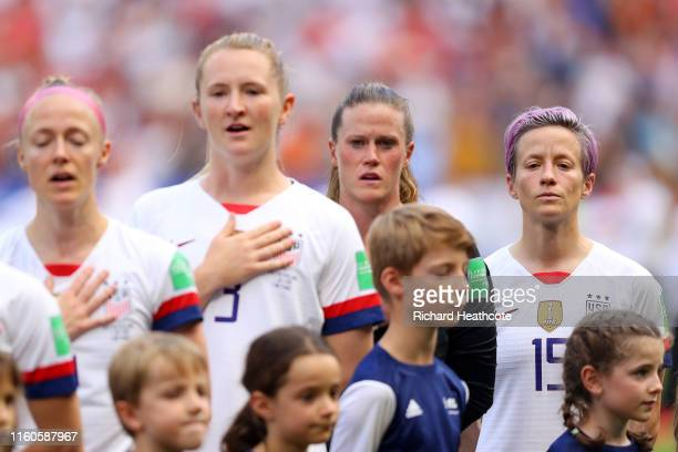 Megan Rapinoe of the USA looks on during the national anthem prior to the 2019 FIFA Women's World Cup France Final match between The United States of...