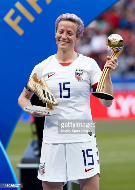 Megan Rapinoe of the USA poses for a photograph with the Golden Boot award and the Golden Ball award following the 2019 FIFA Women's World Cup France...