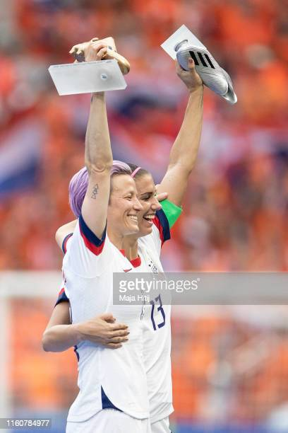 Megan Rapinoe of the USA poses for photos with the Golden Boot and Alex Morgan of the USA with the Silver Boot during the 2019 FIFA Women's World Cup...