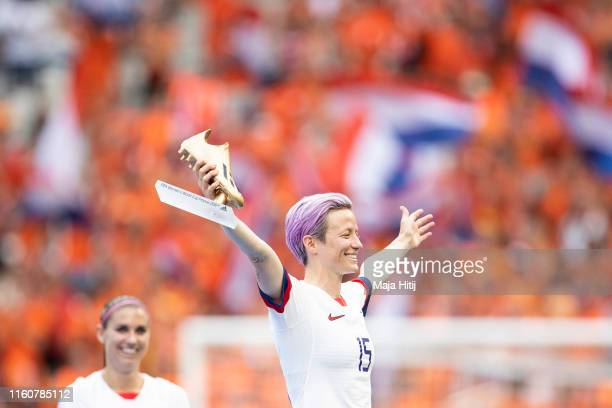 Megan Rapinoe of the USA poses for photos with the Golden Boot during the 2019 FIFA Women's World Cup France Final match between The United State of...