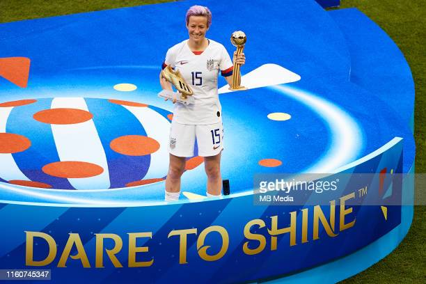 Megan Rapinoe of the USA poses with the Golden Boot and the Golden Ball trophies during the 2019 FIFA Women's World Cup France Final match between...