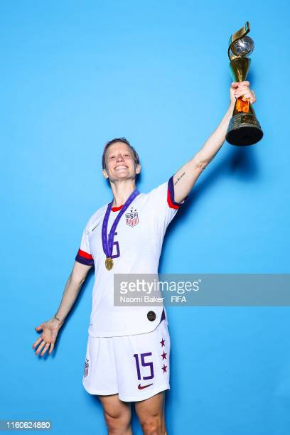 Megan Rapinoe of the USA poses with the Women's World Cup trophy after the 2019 FIFA Women's World Cup France Final match between The United State of...