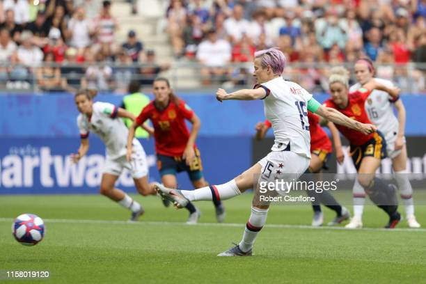 Megan Rapinoe of the USA scores her sides first goal from the penalty spot during the 2019 FIFA Women's World Cup France Round Of 16 match between...