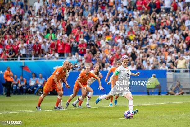Megan Rapinoe of the USA scores her team's first goal during the 2019 FIFA Women's World Cup France Final match between The United States of America...