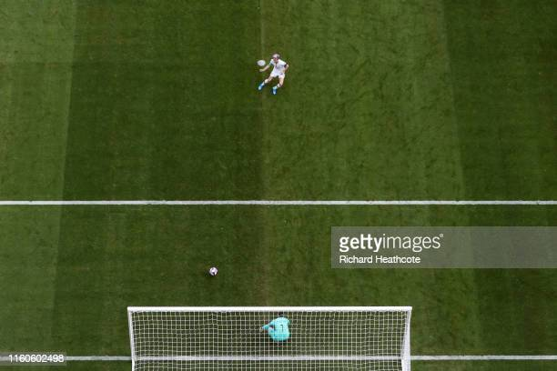 Megan Rapinoe of the USA scores her team's first goal from the penalty spot past Sari Van Veenendaal of the Netherlands during the 2019 FIFA Women's...