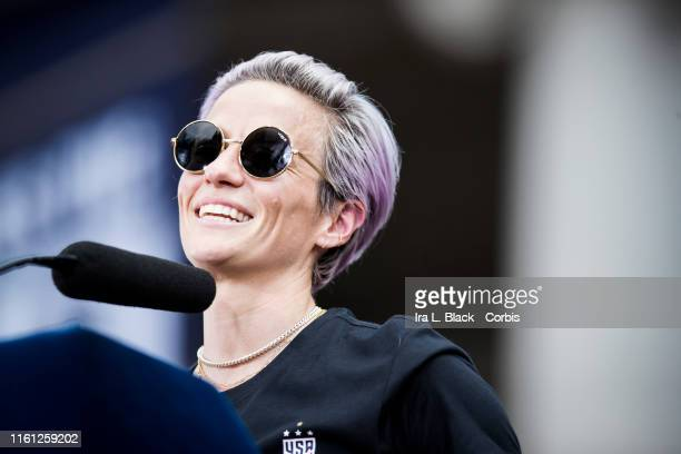 Megan Rapinoe of United States addresses the crowd on the steps of City Hall after the ticker tape parade down Broadway and through the through the...