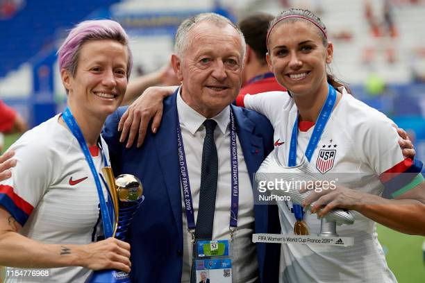 Megan Rapinoe of United States and Alex Morgan of United States pose after winning the 2019 FIFA Women's World Cup France Final match between The...