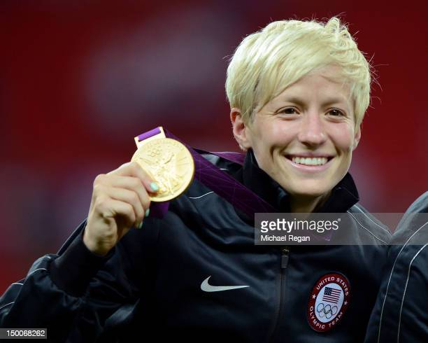 Megan Rapinoe of United States celebrates with the gold medal after defeating Japan by a score of 2-1 to win the Women's Football gold medal match on...