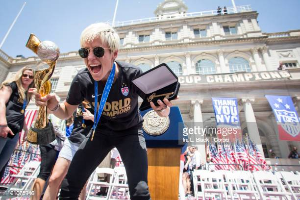 Megan Rapinoe of United States holds the 2015 FIFA World Cup Champions Trophy in one hand and the key to the City of Manhattan in the other hand...