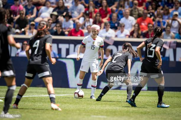 Megan Rapinoe of United States looks for the opening against a group of Mexico team defenders during the International Friendly match the US Women's...