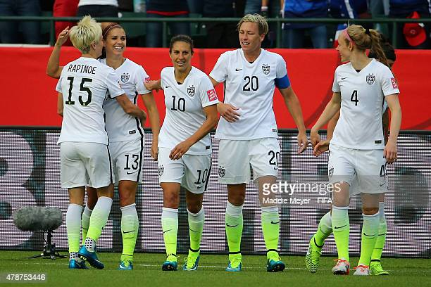 Megan Rapinoe of United States of America Carli Lloyd Abby Wambach and Becky Sauerbrunn congratulate Alex Morgan after she scored a goal against the...