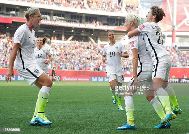 Megan Rapinoe of United States of America celebrates with Abby Wambach after scoring the first goal during the FIFA Women's World Cup Canada 2015...