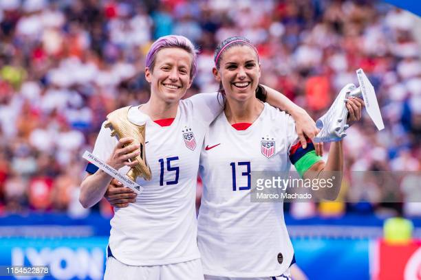 Megan Rapinoe of United States poses for phots with the Golden Boot and Alex Morgan of United States with the Silver Boot during the 2019 FIFA...