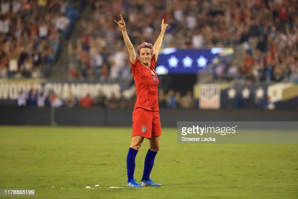 Megan Rapinoe of United States reacts after a goal by teammate Allie Long during their game against Korea Republic at Bank of America Stadium on...
