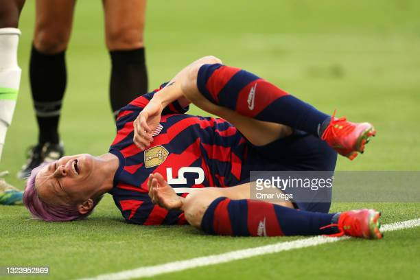 Megan Rapinoe of United States reacts after suffering an injury during the Summer Series game between United States and Nigeria at Q2 Stadium on June...