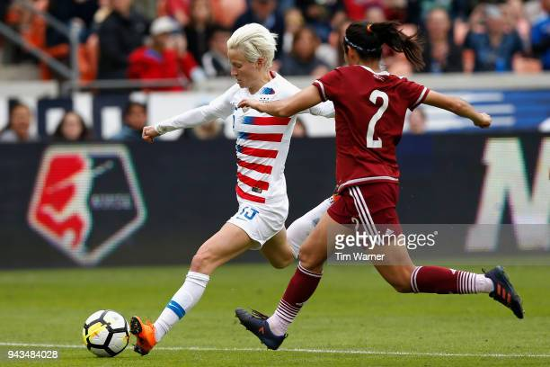 Megan Rapinoe of United States shoots the ball in the second half defended by Kenti Robles of Mexico at BBVA Compass Stadium on April 8 2018 in...