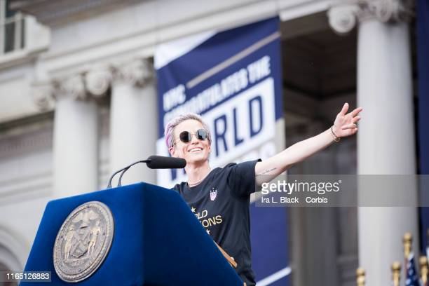 Megan Rapinoe of United States smiles and holds out her hands as she addresses the crowd during the ceremony on the steps of City Hall after the...