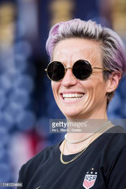 Megan Rapinoe of United States smiles on the steps of City Hall after the ticker tape parade down Broadway and through the through the Canyon of...