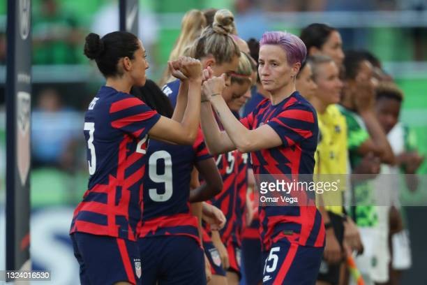Megan Rapinoe of Unites States greets her teammates with her forearms prior to the Summer Series game between the United States and Nigeria at Q2...