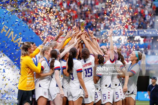Megan Rapinoe of USA and Team USA celebrate the victory of the 2019 FIFA Women's World Cup France Final match between The United States of America...