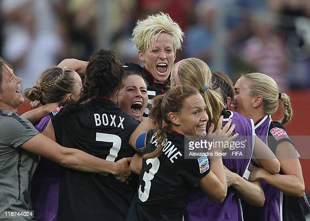 Megan Rapinoe of USA and teammates celebrate their victory of the FIFA Women's World Cup quarter final match between Brazil and USA at RudolfHarbig...