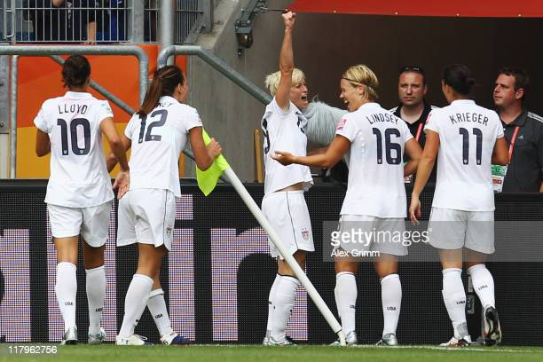 Megan Rapinoe of USA celebrates her team's second goal with team mates during the FIFA Women's World Cup 2011 Group C match between USA and Colombia...