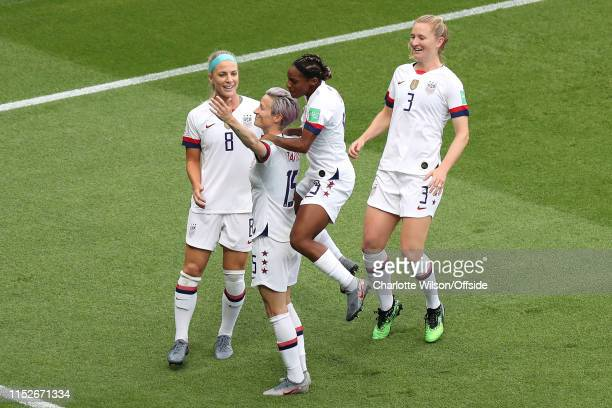 Megan Rapinoe of USA celebrates scoring the opening goal with her teammates during the 2019 FIFA Women's World Cup France Quarter Final match between...