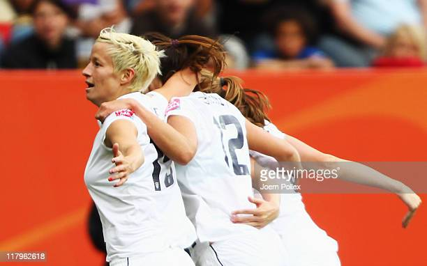 Megan Rapinoe of USA celebrates with her team mates after scoring her team's second goal during the FIFA Women's World Cup 2011 Group C match between...