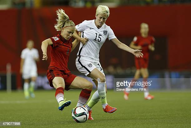 Megan Rapinoe of USA is tackled by Leonie Maier of Germany during the FIFA Women's World Cup 2015 semi final match between USA and Germany at Olympic...